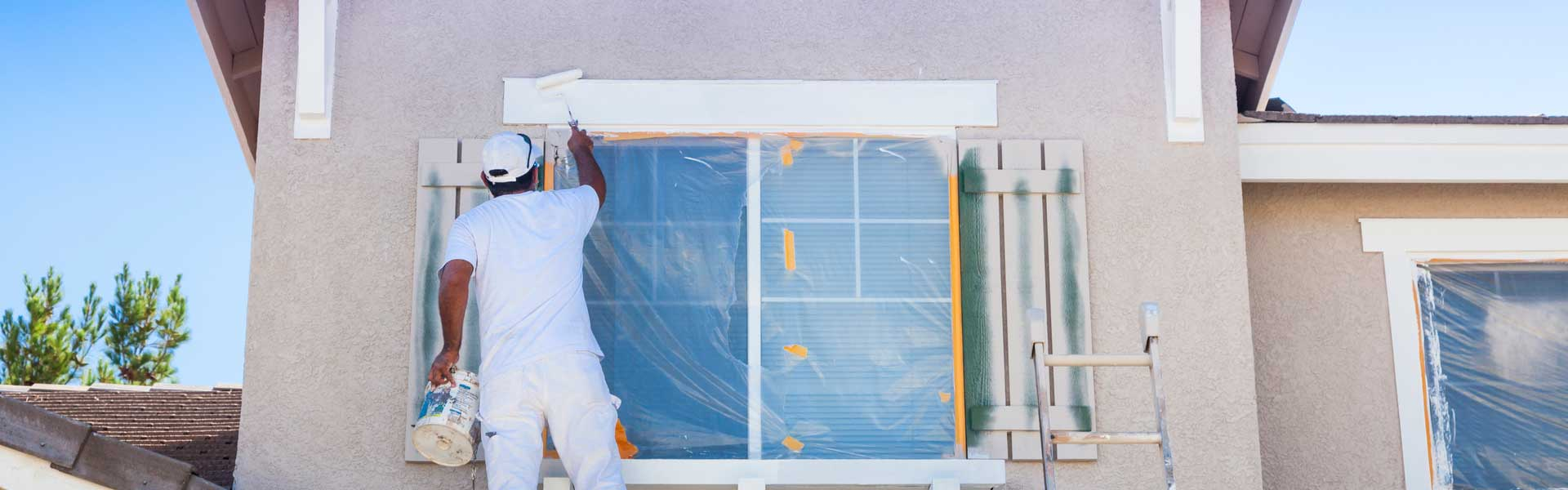 Busy House Painter Painting the Trim And Shutters of A HomeNear Me In Winchester PA